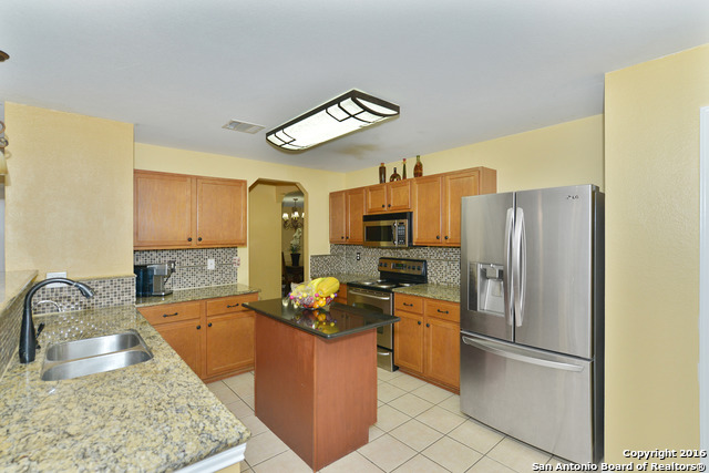 A Large Eat In Kitchen With Island Featuring Pristine Granite Countertops  And Stainless Steel Appliances, Master Bedroom With High Ceilings And ...