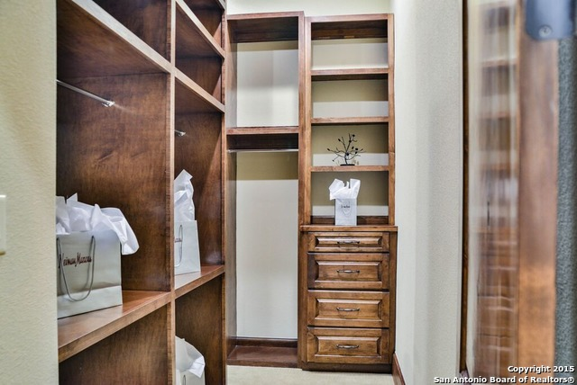 San Antonio, 78257. This Spacious Closet With Elegant Wooden Touches Can Be  Found In This Prime Italian Villa. Imagine How Many Shoes You Could Fit In  Here!
