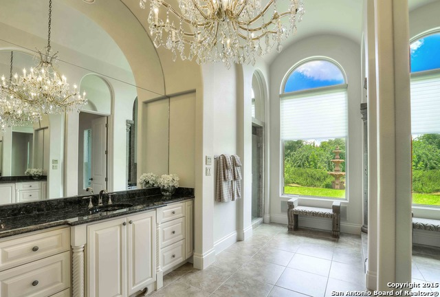 With Clean Lines, Warm Woods, Ceramic Tile Floors And Gorgeous Chandeliers,  You Will Be Blown Away By This Enchanting Master Bath. The Closets Offer  Endless ...